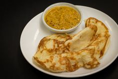 Roti Canai is a soft bread made by tossing and spinning the dough. This popular Malaysian dish, which is of Indian origin, is best eaten with Dhal Curry.