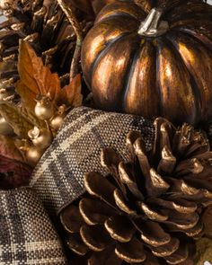 Metallic pumpkins, autumn foliage, and artfully arranged plaid ribbon accents adorn Balsam Hill's Autumn Shimmer Foliage.