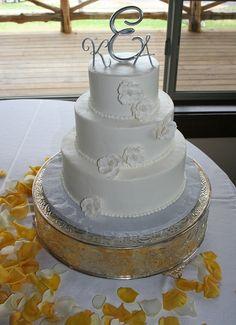 Handmade sugar flowers adorn this classic white wedding cake