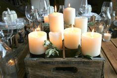 milk crate,  candles, and greenery