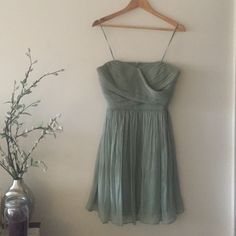 "JCrew Bridesmaid in Dusty Shale ❤️ This JCrew bridesmaids dress is the Arabelle style in Dusty Shale size 6. I purchased the dress ""used worn once"" the dress was a little too large and therefore I haven't worn it. No visible damage that I can see but does need dry cleaned. Retails for over $100. No trades. J. Crew Dresses Strapless"