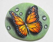 Stone Painting  Monarch Butterfly with Dew Drops ! Is Painted with high quality Acrylic paints and finished with Glossy varnish protection.