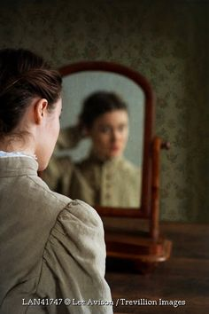 Trevillion Images - victorian-girl-looking-in-mirror