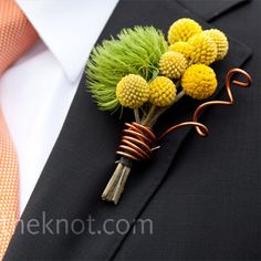 Adding texture to Eric's lapel was a boutonniere created from yellow craspedia with a fluff of greenery alongside.