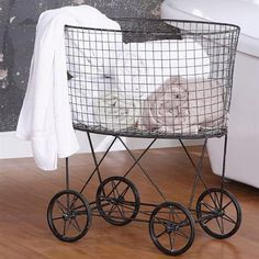 Rustic Metal Laundry Basket with Wheels - A reproduction of vintage laundry baskets, it's perfect to display rolled up bath towels and face towels when guests are in town.