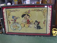 """This is one of my favorites!! It's a huge Pinnochio rug that""""s set inside of a huge frame!!"""