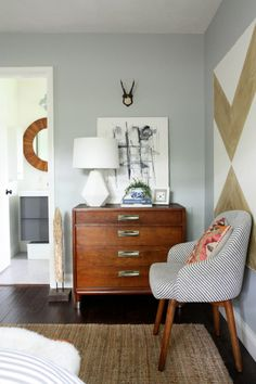 Such a great corner / love the striped chair and the white geometric lamp