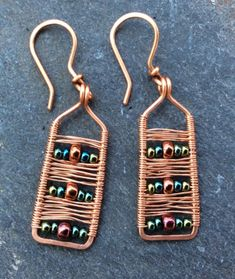 These handmade copper earrings are rectangles with fine wire weaving and metallic glass beads. A rectangular frame is hammered by hand to strengthen and wrapped in an intricate weaving pattern with fine gauge copper wire alternating with 3 rows. Wire Wrapped Earrings, Copper Earrings, Copper Jewelry, Beaded Earrings, Wire Jewelry, Earrings Handmade, Beaded Jewelry, Handmade Jewelry, Hoop Earrings
