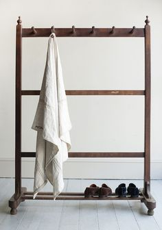 in teak, of great scale and of stylish and functionalform, with six turned woodpegs and two lower rails, the uprights toppedwith finely turned finials, from Bombay, a type of furniture that is now extremelydifficult to find and is in lovely unrestored original condition,c.1860/1870
