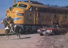 Bronco Billy, the train and the Cadillac.  http://www.dailymotion.com/video/x5okmv_attaque-d-un-train-rate_creation