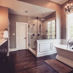 "Beautiful master bath. Love the ""hardwood"" tiles, gorgeous shower, and freestanding tub."
