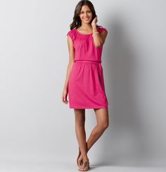 """Make any day flirty with this totally charming knit dress, finished with pretty smocked details. Scoop neck. Cap sleeves. Elasticized smocked neckline and cuffs. Self sash at waist. Gathered above and beneath waist seam. 19 1/2"""" from natural waist.  Style #277461  60% Cotton, 40% Modal"""
