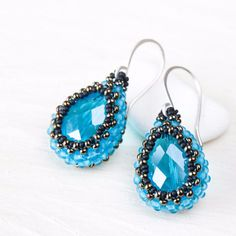 Water blue beaded bead earrings, faceted blue glass drop in beadwoven bezel