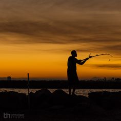 A fisherman casts his line at the San Gabriel Valley River Jetty in Seal Beach, California.