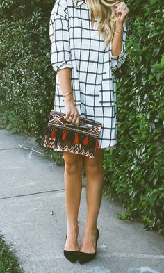 Foldover tassel clutch + checker pattern + heels