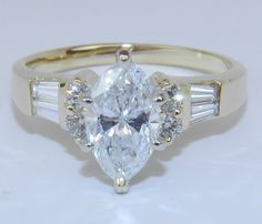 14K Yellow Gold 1.43 ct Marquise Natural Genuine Diamond Engagement Ring. $3,489.00, via Etsy.