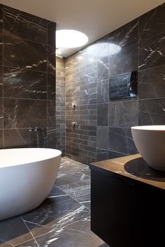 ensuite - black marble tile floor  Staffan Tollgard Design Group-Kensington Penthouse