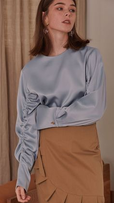 This sky-blue silk top is pure elegance.Loéil Azour Top, $135, available at Loéil. #refinery29 http://www.refinery29.com/2016/09/124841/fall-colors-clothing-trends#slide-16