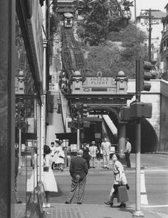 Angels Flight ferrying passengers up and down Bunker Hill, seen in its original location at 3rd and Hill on a sunny day in the late 1950's.