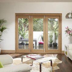 """We deliver all external TruFold Supreme doors for free, ANYWHERE MAINLAND UK! These external folding doors are available in two sizes and the doors are 46mmm thick, the image shows a typical oak set Compliant with UK building regulations, the external folding doors are sold complete with frame, 24mm thick toughened clear """"Low E"""" double glazing, hinges, Polished Chrome handles, locking system and draught excluders, opens out, all pre-machined for locks etc, glass is installed in the doors…"""