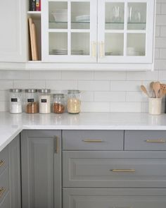 Love it when the lower cabinets are a color and the uppers are white!