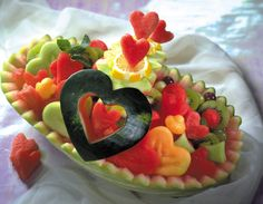 We had a watermelon basket of fruit at my dad's Masters degree grad party when I was little...but with a fun new design, what a pretty carving idea for a bridal shower or engagement party, perhaps! -KWA