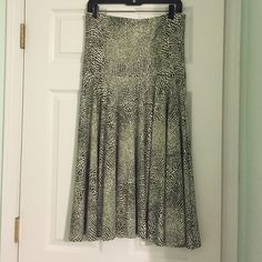 strapless dress/ flowey skirt J. McLaughlin. never worn/perfect condition. super pretty pattern. comfortable. can be worn as a skirt or strapless dress. pretty black and white pattern J. McLaughlin Dresses Strapless