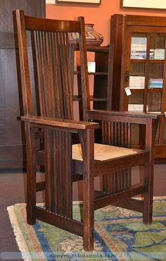 Gustav Stickley tall back spindle arm chair. This icon of the period is in very good original finish and condition. It does have a new natural rush seat. All the spindles are straight and true, very important in this design. American Craftsman, Craftsman Style, Craftsman Homes, Craftsman Furniture, Antique Furniture, Antique Chairs, Wooden Furniture, Arts And Crafts Furniture, Furniture Projects