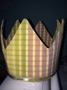 Little Princess crowns. In yellow purple and gold print with metallic gold trim.