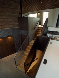 Stairway to Heaven by Wood Arkitektur + Design uses heat-treated pine and bricks to fashion a casual family retreat. Decor Interior Design, Interior Decorating, Blinded By The Light, Villa, Mansions Homes, Stairway To Heaven, Stairways, Home Art, Beautiful Homes