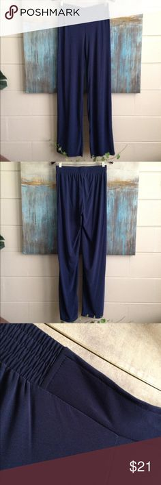 Iman Navy Palazzo Pants Size Medium Long Super slinky Iman palazzo pants with elastic tab waist and 10 inch wide leg. Size Medium Tall / Long. Color Navy Blue. Material 96/4 Poly/Spandex. Measurements waist: 13 1/2, inseam: 34, rise: 8.5 Iman Pants