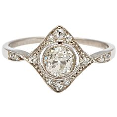Diamond in a Diamond Art Deco Engagement Ring | From a unique collection of vintage engagement rings at http://www.1stdibs.com/jewelry/rings/engagement-rings/