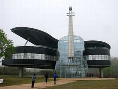 Chris Cho: The Piano House located in Huainan City, An Hui Province, China. It contains a transparent violin and a piano building. Inside the violin, there is staircase toward the piano house upstairs. Unusual Buildings, Interesting Buildings, Amazing Buildings, Architecture Cool, Online Architecture, New District, Unusual Homes, House Music, Music Life