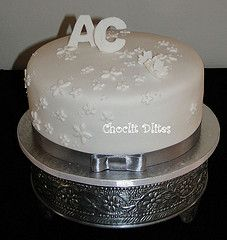 Single Tier Wedding Cake - 3 layers of carrot and pecan sponge, filled with a light lemon buttercream. Covered with fondant, embossed flowers and initials. Tire Wedding Cakes, Wedding Cake With Initials, Cupcake Cakes, Cupcakes, Lemon Buttercream, Novelty Cakes, Butter Dish, Pecan, Carrot