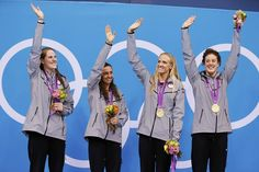 (L-R) Missy Franklin, Rebecca Soni, Dana Vollmer and Allison Schmitt pose with their gold medals after winning the women's 4x100m medley relay final.