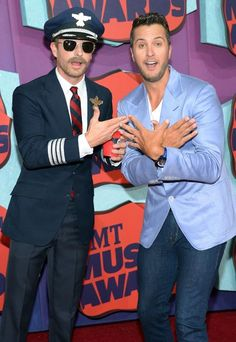 """Dierks Bentley, dressed as a pilot for his """"Drunk on a Plane"""" single, fools around with Luke Bryan at the 2014 CMT Music Awards."""