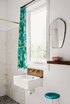 great faucet and wooden backsplash.  I also really like the curtain addition