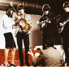 """23rd November 1964. The Beatles and Cathy McGowan during rehearsals for """"Ready Steady Go""""."""
