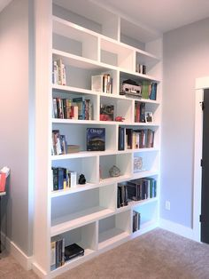 We installed these built in floor to ceiling bookshelves in a home office, and they're a great use of a shallow space behind a door. Painted Back Bookshelves, Diy Bookshelf Wall, Built In Shelves Living Room, Home Office Shelves, Floor To Ceiling Bookshelves, Office Built Ins, Office Bookshelves, Bookshelves In Bedroom, Bookshelf Design
