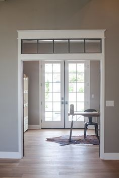 Home office with transom window entry - by Rafterhouse.