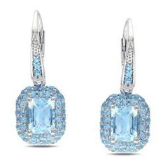 @Overstock - These stunning dangle earrings feature round-cut Swiss blue topaz gemstones encircling large, emerald-cut sky blue topaz gemstones. Crafted of sterling silver, these beautiful earrings shine with a highly polished finish and secure with leverback clasps.http://www.overstock.com/Jewelry-Watches/Miadora-Sterling-Silver-Blue-Topaz-Dangle-Earrings/6075494/product.html?CID=214117 $169.99