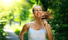 happy woman running outdoors