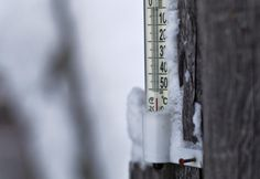 A thermometer shows a temperature around -55 degrees Celsius in the village of Tomtorin, in northeast Russia, on January 22, 2013.