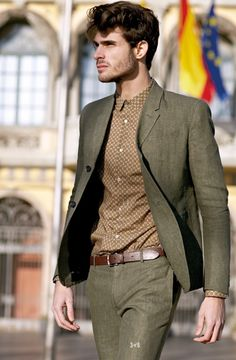 Great combo of shirt and suit and the belt color compliments both.