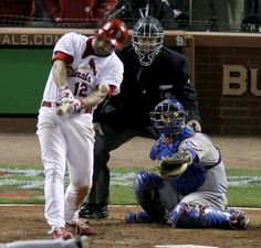 Lance Berkman smacks a clutch single in the 10th inning of Game 6 of the 2011 World Series.