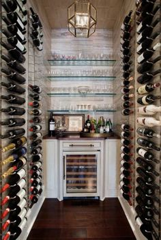 Wine room with bottles from ceiling to floor.  Small built in around wine frig, very nice!