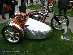 Handsome Airstream-inspired custom motorcycle and side car by Jesse James.