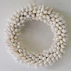 Small White Strombus Shell Wreath (http://www.caseashells.com/small-white-strombus-shell-wreath/) #seashellwreath, #shellcrafts, #beachdecor, #californiaseashellcompany