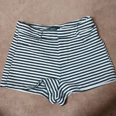 Super cute High waisted shorts! These are from forever 21 and I love them but they are just too short on me. Worn a couple times but in amazing condition! Black and white striped. 97% Polyester 3% Spandex Forever 21 Shorts