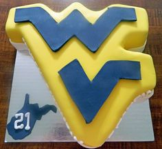 WVU Cake 21st Birthday: Guinness Chocolate Cake, Irish Whiskey ganache, & Bailey's Irish Cream frosting.